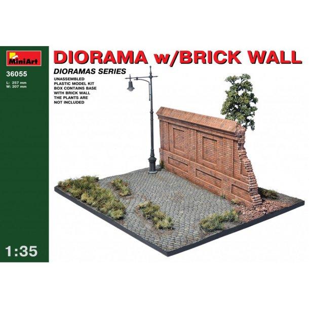 Diorama med murstenvæg og gadelampe